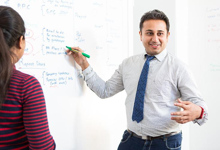 man, white board, meeting, brochure